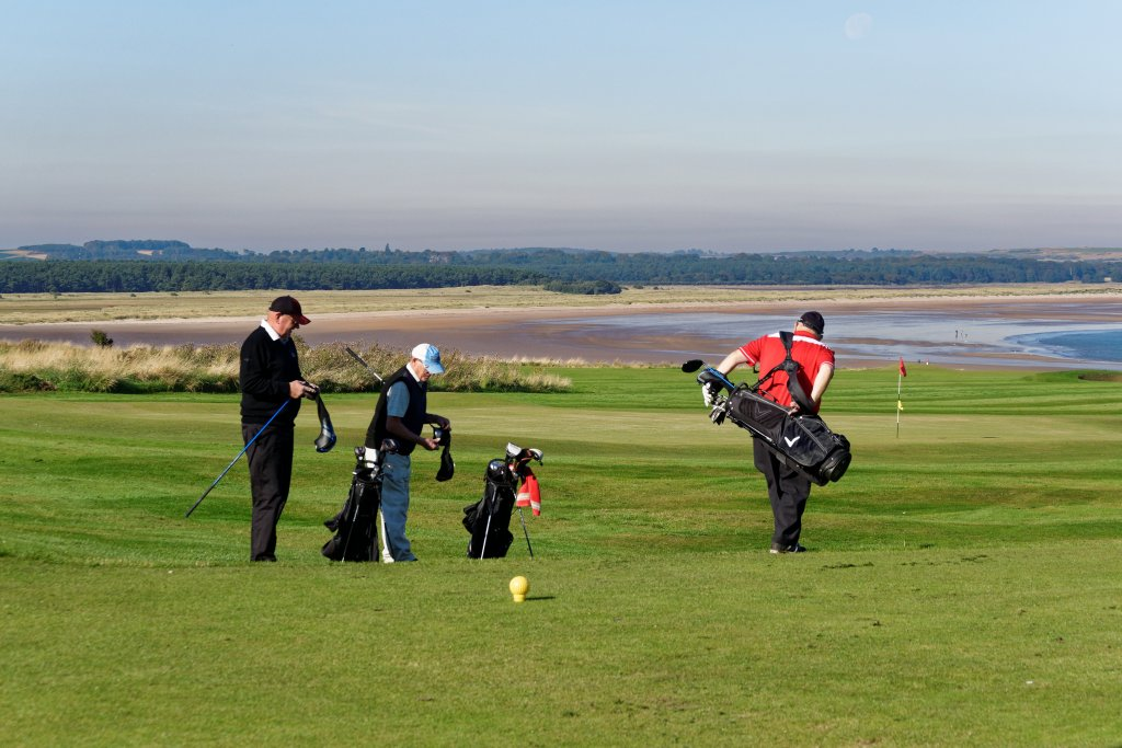 Golfers practicing social distancing
